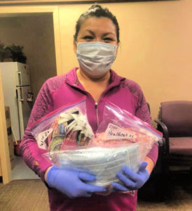 HealthNet staff with facemask donation